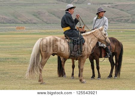Kharkhorin, Mongolia, July 8, 2013 : Two Riders Wait In The Steppe Before Naadam Festival. Half Of M