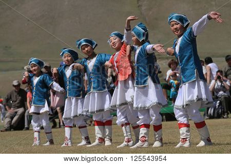 KHARKHORIN MONGOLIA JULY 8 - Traditional dances during Naadam midsummer festival on July 8 2013 in Kharkhorin Mongolia. Naadam is inscribed on the Representative List of the Intangible Cultural Heritage of Humanity.