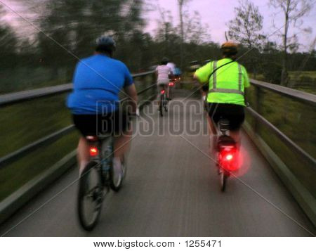 bike riders at night with back lights