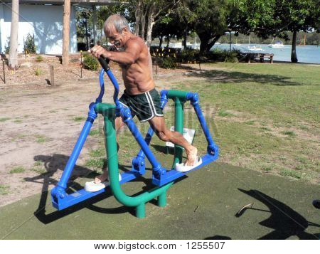Man Doing Workout On Exercise Machine