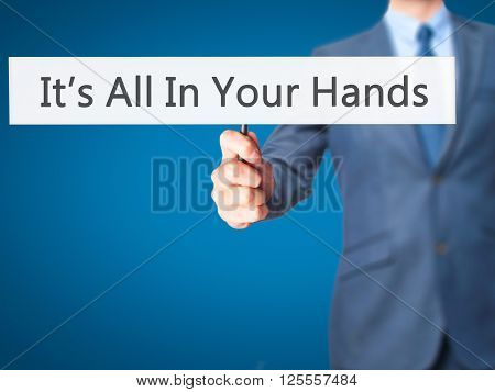 It's All In Your Hands - Businessman Hand Holding Sign