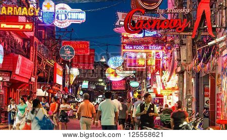 PATTAYA THAILAND - JANUARY 14 2016: unidentified crowd of people under the neon signs at Walking Street in Pattaya on January 14 2016. Walking street is popular for clubs bar and night life