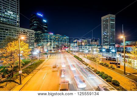 View Of Traffic And Buildings Along Light Street At Night, In The Inner Harbor, Baltimore, Maryland.