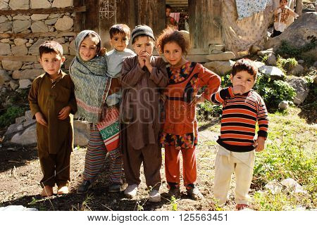 Kalaam, KPK, Pakistan - Oct 15, 2015 - Happy kids of beautiful village getting amused by tourist and their photography equipments.