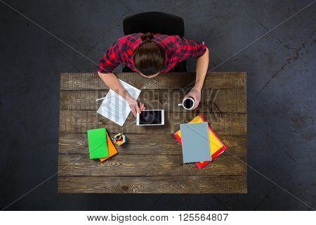 Top view creative photo of businessman sitting at dark wooden vintage table. Businessman using tablet computer. There are documents on table