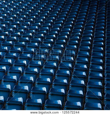 Background of empty blue stadium seats grandstand