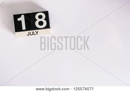 July 18th. Image of july 18 wooden color calendar on white background. Summer day. Empty space for text.
