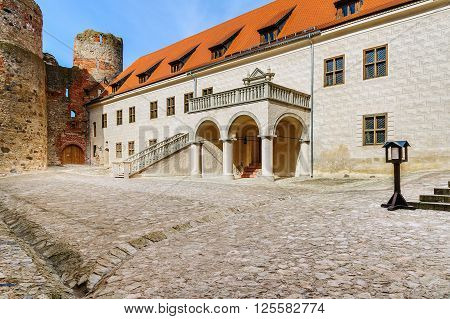 BAUSKA, LATVIA - APRIL 4, 2016: Courtyard with beautiful stairs of medieval castle in Cesis town, Latvia