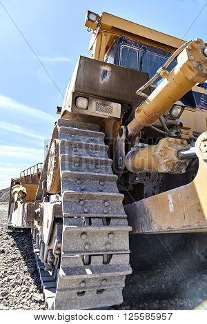 heavy construction equipment excavator bulldozer steel gear link belt cog transmission closeup