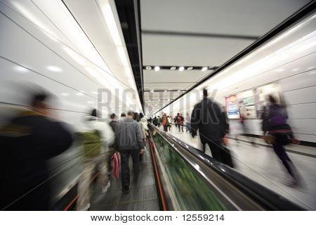 Dynamic photo of busy crowd of people walking blurred motion. poster