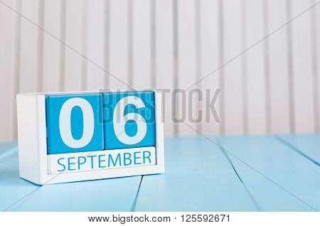 September 6th. Image of september 6 wooden color calendar on white background. Autumn day. Empty space for text.