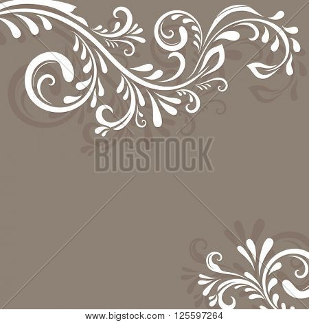 Beige background with floral ornament and copy space.
