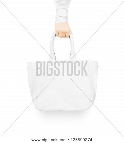Hand holding blank white women's leather bag mock up isolated. Woman handbag design presentation. Hand hold woman leathern bag. Women accesory bag mockup.
