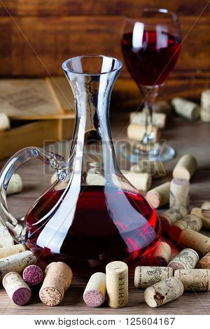 Background with glass of wine decanter and wine corcs. Wine concept