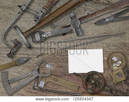 vintage jeweler tools and diamonds over wooden bench space for your business name