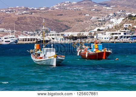 Two boats moored in Mykonos harbour Greece