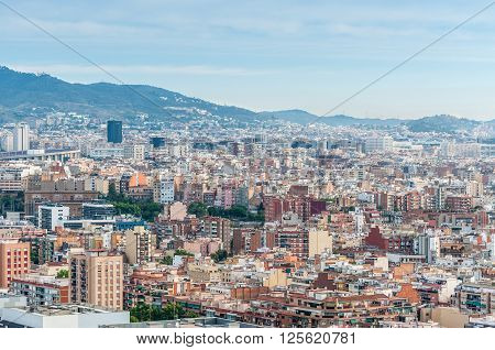 Barcelona Spain - May 18 2014: The view of Barcelona from high up in the Renaissance Barcelona Fira Hotel. Visible La Caixa Towers (