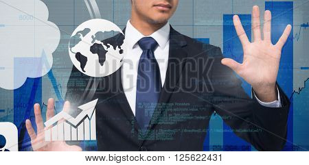Unsmiling businessman touching against blue data