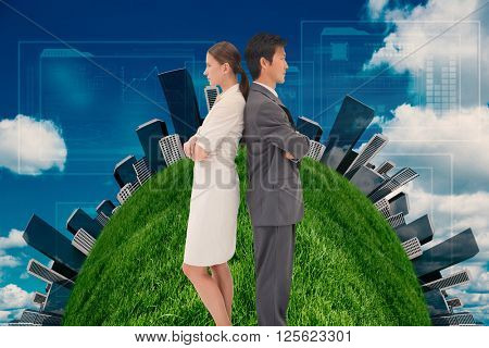 Serious business people standing back-to-back against scenic view of blue sky