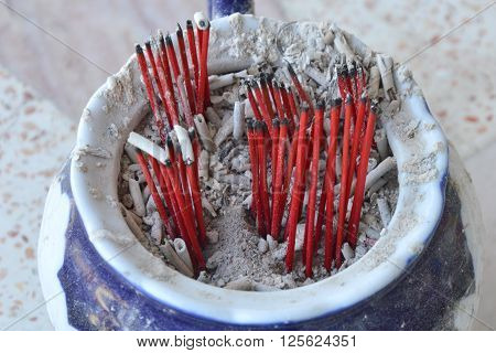 red wood incense stick on ash tray