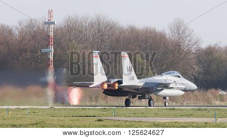 LEEUWARDEN NETHERLANDS - APRIL 11 2016: US Air Force F-15 Eagle takking off during the exercise Frisian Flag. The exercise is considered one of the most important NATO training events this year.