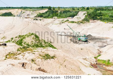 Yantarny, Russia - June 30, 2010: Extracting of amber ore in open-cast mining