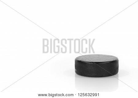 Hockey puck closeup on a white background. Hockey background object