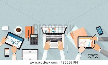 Business team working together at office desk they are using laptops and checking financial reports corporate management and accounting concept