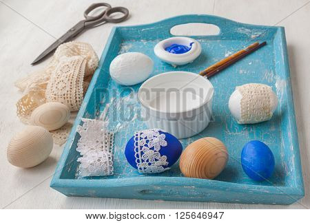 Coloring Easter eggs and decoration lace. Easter art and handicrafts