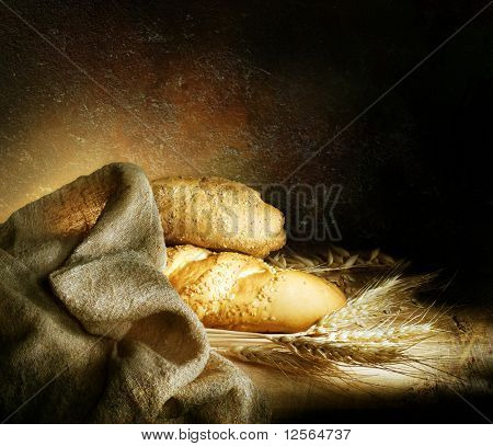 Vintage Styled still-life with bread and wheat ears