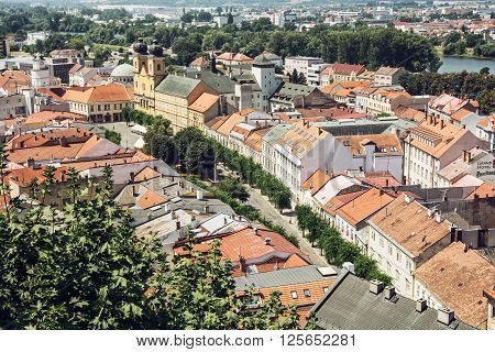 Historic centre of Trencin city Slovak republic. Urban scene. Piarist church of saint Francis Xaversky.