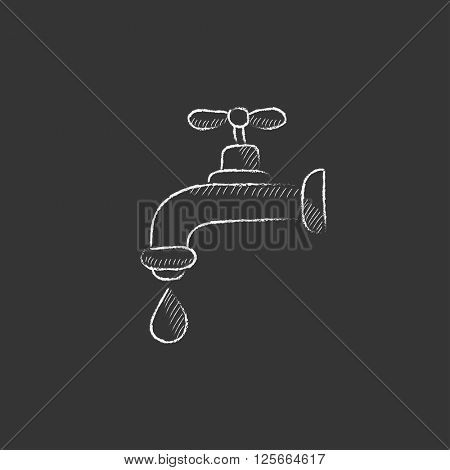 Faucet with water drop. Drawn in chalk icon.