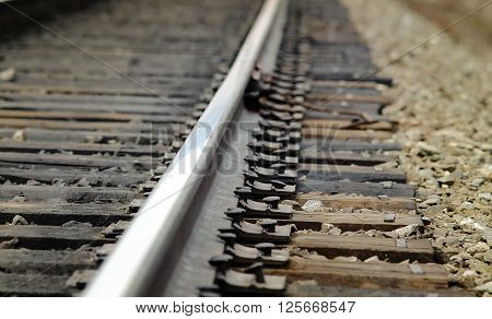 Railway rails stretching to the horizon . ** Note: Shallow depth of field