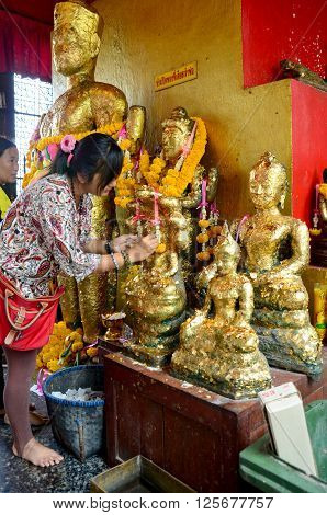 Thai Woman Glid Cover Angel Statue With Gold Leaf At Phra Kal Shrine