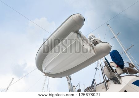 Dingy boat Inflatable setup behind of the yacht for transportation
