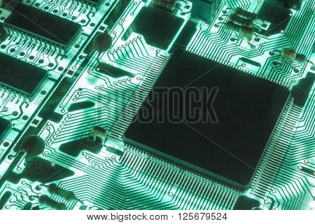 Circuit green background a computer with a microchip.