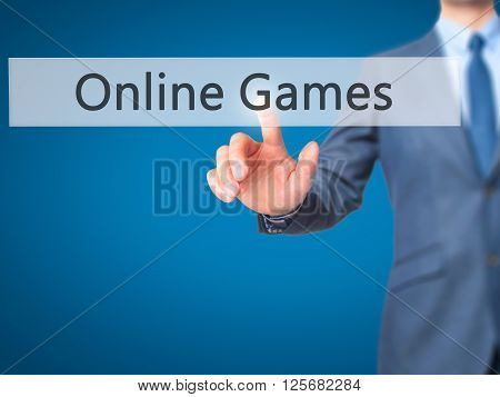 Online Games - Businessman Hand Pressing Button On Touch Screen Interface.