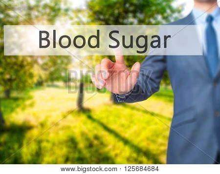 Blood Sugar  - Businessman Hand Pressing Button On Touch Screen Interface.