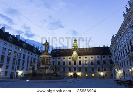 In der Burg - the largest enclosed square of the Hofburg Palace complex with monument to Emperor of Austria Francis I in Vienna in Austria