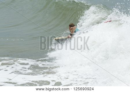 Man Body Boarder surfing on the waves Sea beach