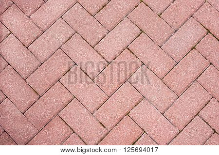 Red brick pavement background texture close up