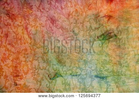 Colorful ethnic pattern fabric background texture close up