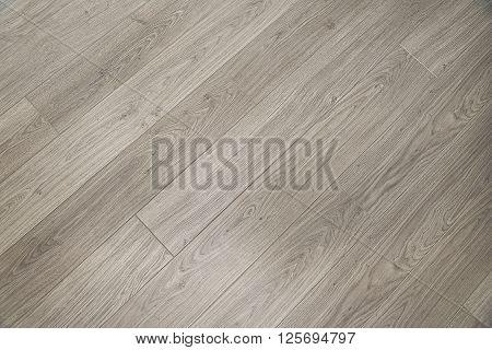 Light grey wooden floor background texture close up