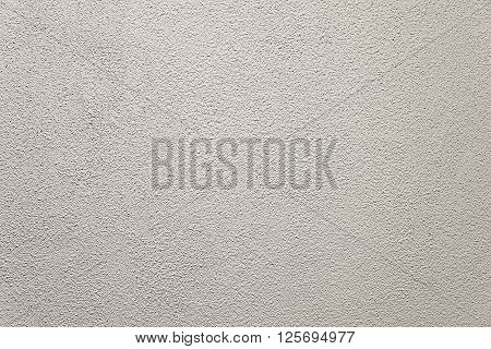 Light grey concrete wall background texture close up