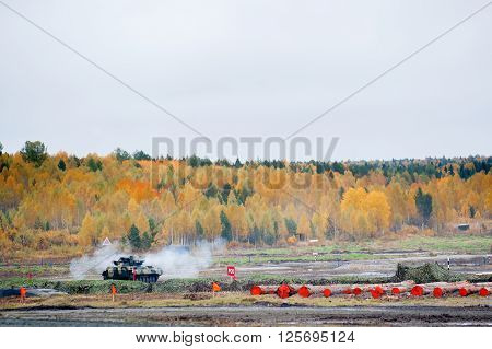 Nizhniy Tagil, Russia - September 27. 2013: Firing from tank machine gun by tracer bullets in motion. Russia Arms Expo-2013 exhibition