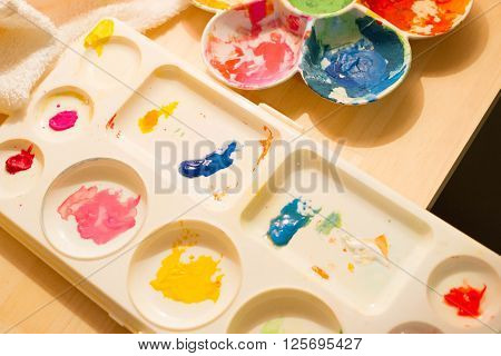 a color palette on table with happy