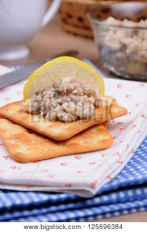 Snack of fish paste herring (forshmak) on crackers close up