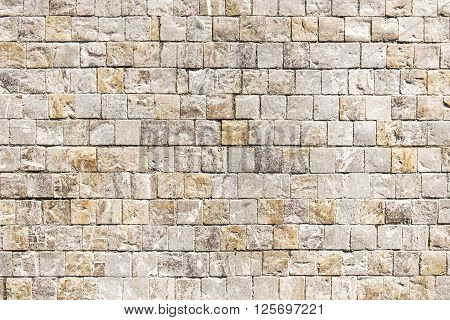 Old mosaic stone wall background texture close up