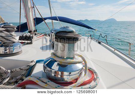 Sailboat Winch and Rope closeup Catamaran Yacht detail. Yachting Phuket Thailand