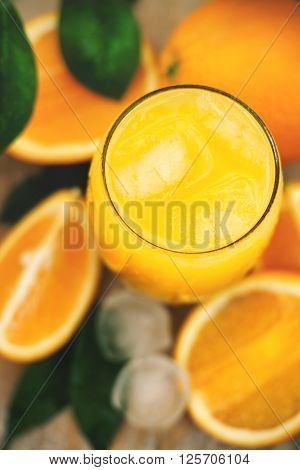 Glass of fresh orange juice with ice